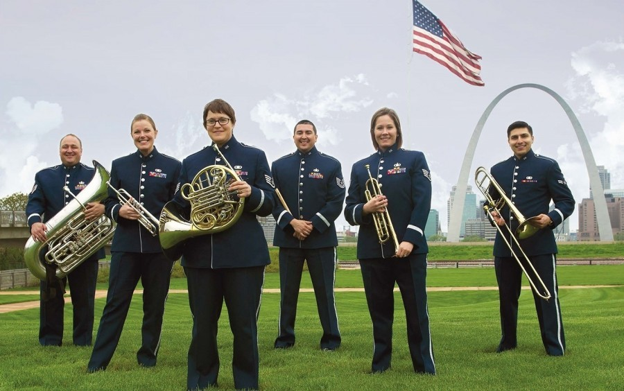 The United States Air Force Airlifter Brass standing with the Gateway Arch and American flag in the background