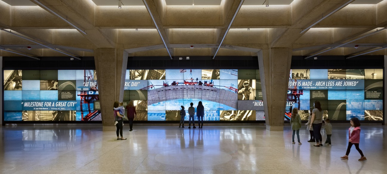 Video Wall - In the tram lobby, the video wall is a 100 ft. wide wall of monitors showing videos of the building of the Gateway Arch and scenes of American history and innovation, which are embodied in the Gateway Arch's symbolism.