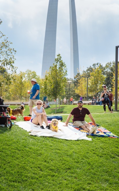 people at the park in front of arch