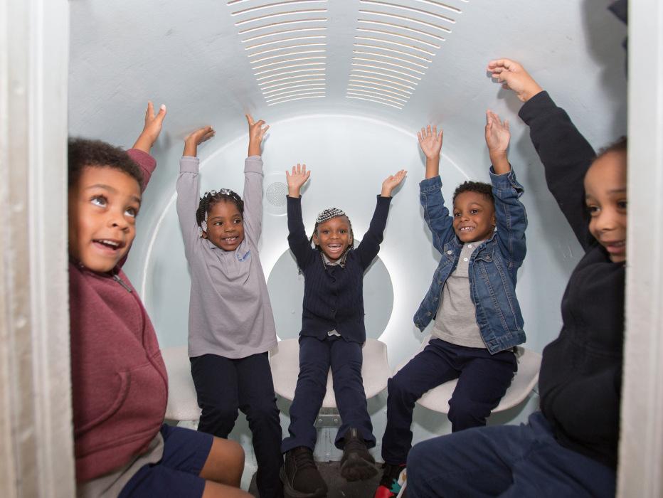 Journey Fund kids in Arch Tram
