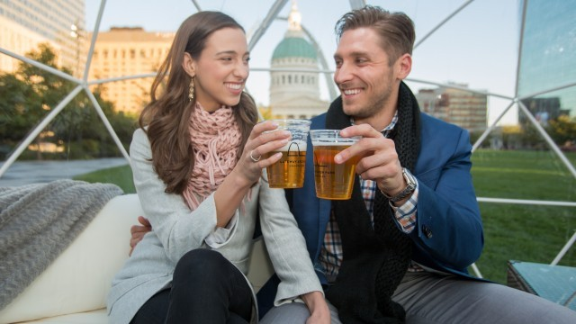 Couple toasting with beers in Igloo
