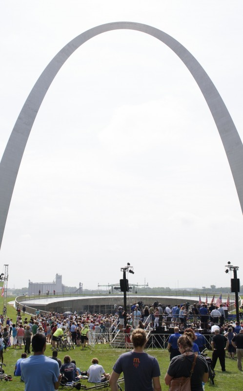 Grand opening day photo of arch and people at opening