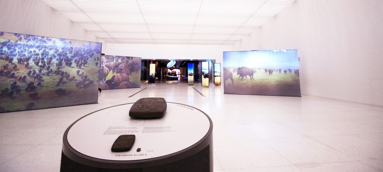 Heading West - Visitors entering the museum at the Gateway Arch are greeted by seven monumental video screens that show scenes of American Indian culture, overlanders on historic trails, amazing landscapes, and more.