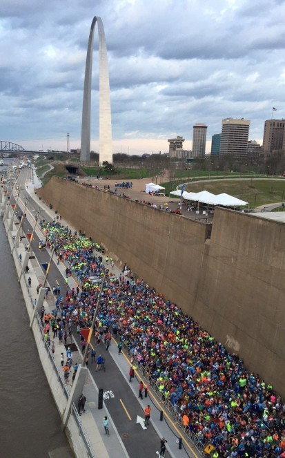 People walk along the Riverfront