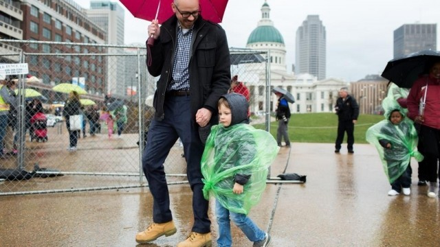 McClure with his son, Harrison, walking over the new park space over I-44 on its opening day in 2018.